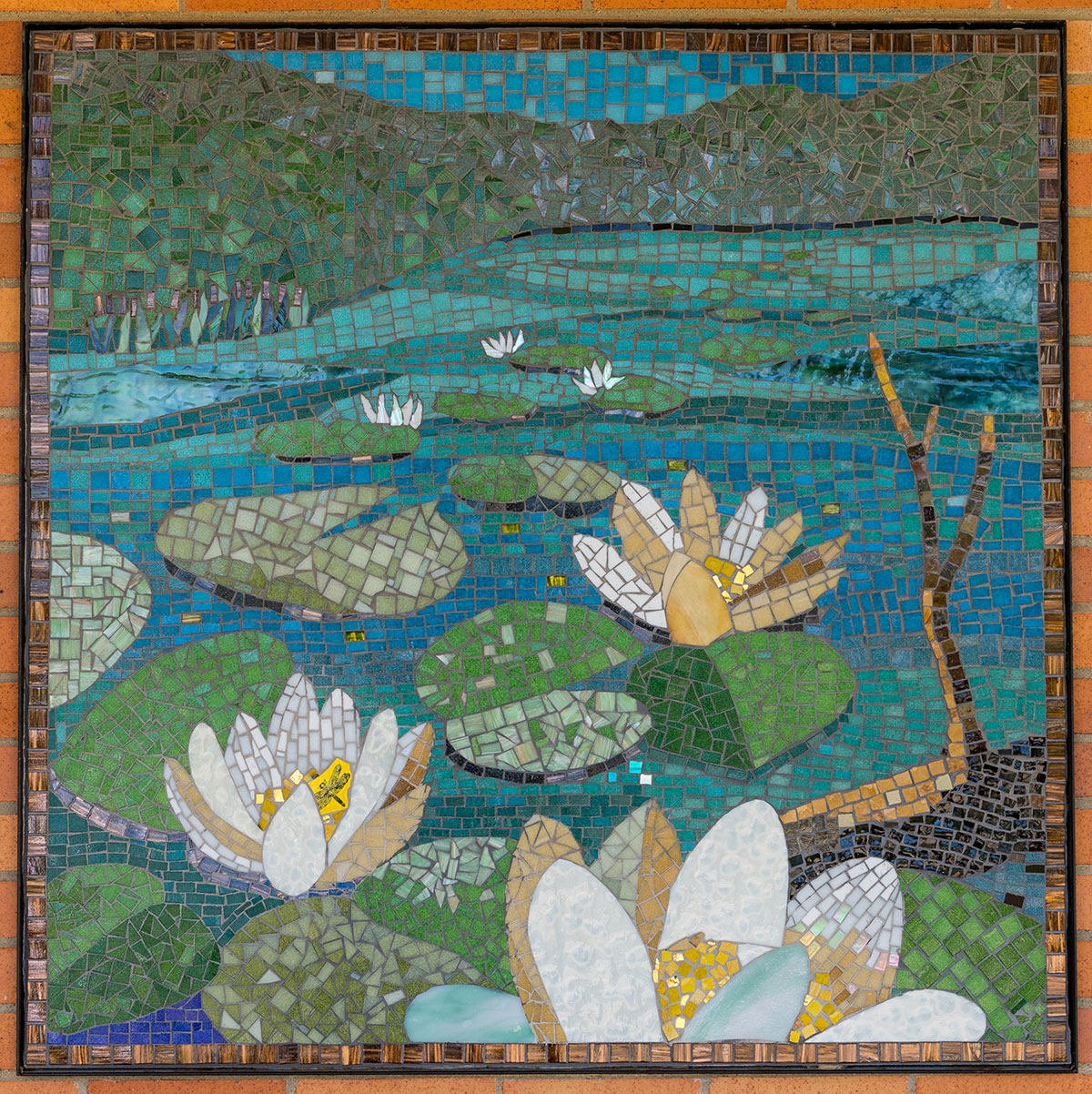 Mural depicting lily pads on a pond.