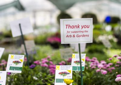Flowers and a sign that reads: Thank you for supporting the Arb & Gardens.