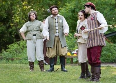 Shakespeare in the Arb 2018 cast members performing a scene.