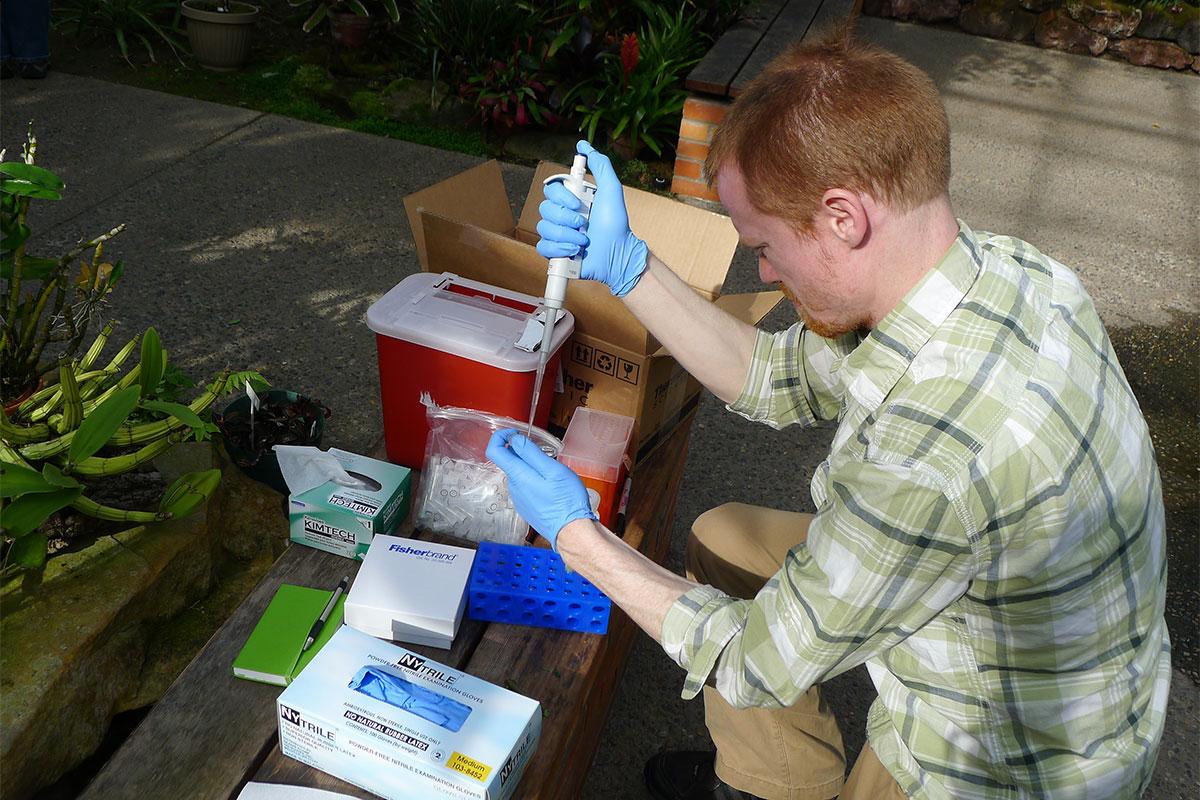Student conducting research at Matthaei Botanical Gardens