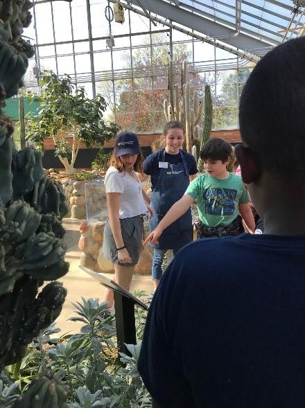 Kids on tour of arid house