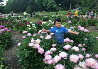 Allison's son Jason in the Nichols Arboretum peony garden