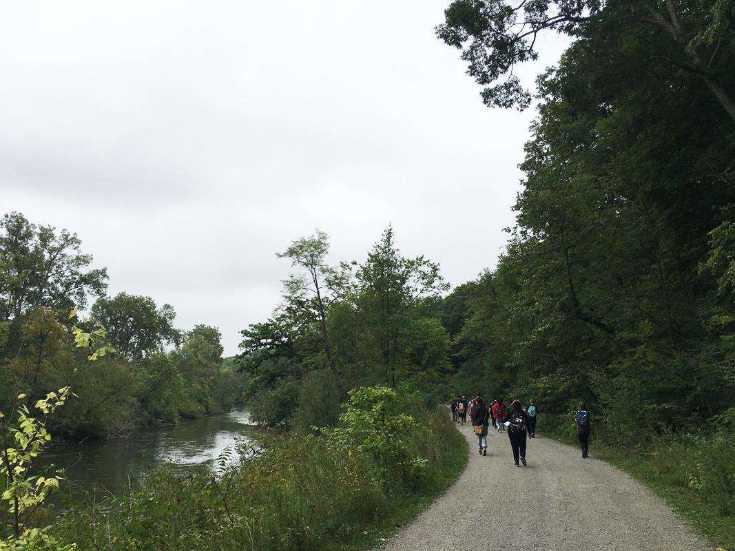 Outdoor class walks along river